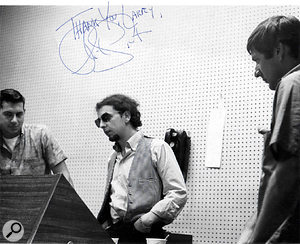 Levine, Spector and Sonny Bono at the desk — signed 'Thank you Larry' by Spector.