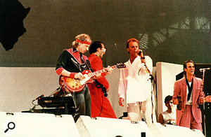 Dire Straits at Live Aid in 1985, with Sting reprising his vocal on the intro to 'Money For Nothing'.
