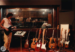 Bassist John Illsley in the live room at AIR Montserrat, with a selection of Mark's guitars...