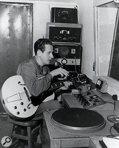 Les Paul at work in his home studio.