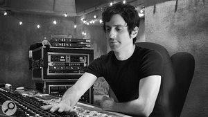 Producer Steve Evetts behind the desk