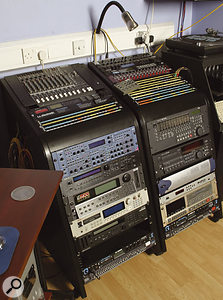 Some Kenwood rack gear (from top, left to right): Mackie mixer, TC Electronic Finalizer 96K mastering processor and Gold Channel input channel, Novation Supernova II synth, Roland JV1080 sound module, Emu E6400 and Akai S3000XL samplers, Korg M1R sound module, MOTU MIDI Timepiece AV and Furman graphic EQ; Behringer Powerplay headphone amplifier, Drawmer DS201 dual gate, TC Electronic M•One and Digitech Quad multi-effects, iX One line mixer, Tascam MX2424 multitrack recorder and DA40 DAT recorder, Digidesign HD96 interface, M-Audio Digipatch digital patchbay, Alesis ADAT multitrack recorder, and another MOTU MIDI Timepiece and Furman EQ.