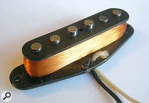 The inside of a single-coil Strat pickup, showing the rod magnets wound with insulated wire.