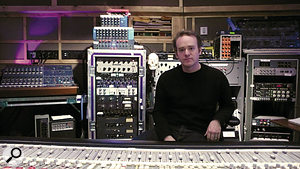 Rich Costey, photographed in New York's Avatar Studios with some of his personal collection of outboard gear. The skull in the background is actually a binaural mic!