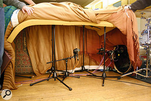 The tone of the kick drum changes dramatically as you move away from the batter head, so we recorded five AKG D112s at different distances to demonstrate this, generating the 'KickDistance' file sets. The amount of spill from other instruments also increases with distance, and many producers baffle the mic stands and kick drum with blankets to reduce this, so we created the 'KickDistanceBlankets' files to show how much of a difference this can make. In these photos you can see the final baffled setup and how the mics were positioned inside.