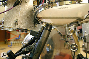 Five classic snare mics were compared over the top of the drum for the 'SnareMics' audio files (left, clockwise from top left): a Neumann KM84, a Shure SM57, an AKG C451EB, a Neumann KM86 and an AKG C414B-ULS. Above, under the snare were a further SM57 and C451EB.