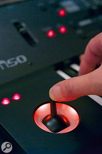 The M50's orange-lit joystick control makes it very unlikely that you'll not be able to locate it in the dark.