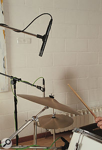 The overhead mics you use to capture the stereo spread of the drum kit will usually pick up the cymbals well enough.