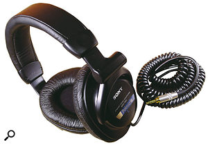 Although closed-backed headphones often suffer sonically, the Sony MDR7509s shown here buck the trend, and would be a good choice for mixing duties. The single cable from the left headphone makes this model easy to put on and remove, but some users may find the pull from the curly cable on that side uncomfortable.