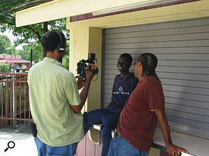 Filmon Mebrahtu (with camera) working on an interview for Dinka Diaries.