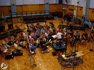 Cut scenes in the game featured specially written music which was tracked in Abbey Road Studio 1, for a more expansive feel. Visible above the conductor is the Decca Tree array of three microphones, with the very high stands containing ambience mics which were eventually used to feed reverb units.