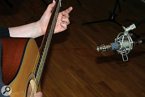 As arelatively compact sound source, an acoustic guitar doesn't generate much stereo information, so miking with asingle mic and then using pseudo‑stereo processing in the mix may be more effective than miking in stereo.