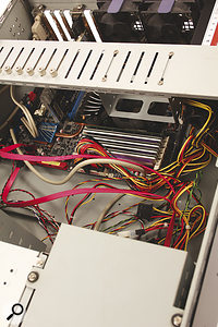 A mess of cables inside your computer case will inhibit airflow — so get the cable clips out and tidy them up!