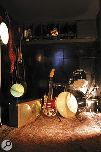 The soundproofed room is home to Robbie's Gibson GA-30RVS guitar amp,  his drum kit, numerous guitars and other miscellaneous gear.