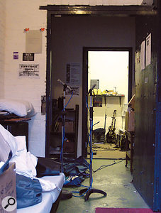 The 'reverb' you hear on records is sometimes the result of ambient miking techniques, rather than artificial reverb. Opening the doors of a studio and placing ambient mics in hallways or adjacent spaces, as described by producer Ben Hillier, seems to be a popular technique.