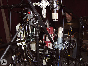 Somewhere behind this huge array of mics you can just about make out the drummer helping us test the ribbons for use as mono room mics.