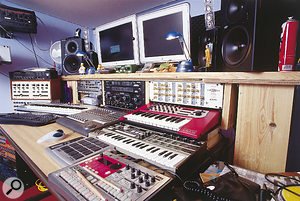 The main working area in Roger Lyons's studio, which is based around an Apple Mac computer and a Mackie Control fader surface.