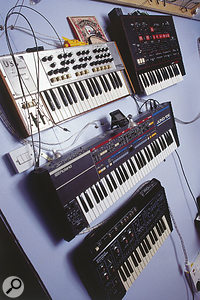 The alternative to keyboard stands: Roger Lyons's studio wall holds a selection of vintage synths.