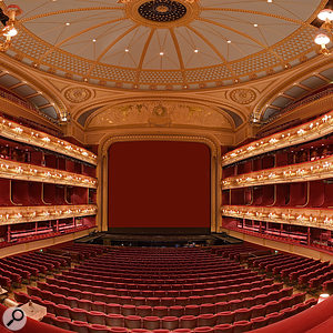 The Royal Opera House stage, with its large proscenium arch. The orchestra pit is visible just in front of the stage.