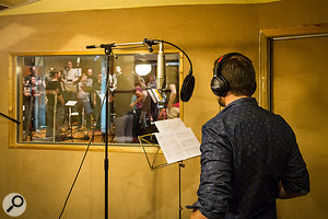 All lead vocals on the session were recorded in the studio's isolation booth to allow more flexible editing between takes.