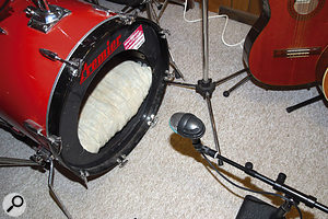 Peter's original kick mic positioning several inches outside the body of the drum didn't give nearly as much definition to the recorded sound as miking close to the batter head inside the drum.