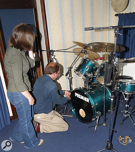 The band had been working with their bass drum filled with bubble wrap, on the advice of another drummer. However, this was not producing a suitable sound for recording purposes, so it was removed and replaced with some heavy blankets. The front head was also removed, because the hole cut into it was too small to allow much flexibility in mic positioning.