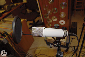 Paul and Hugh quickly noticed Peter's unusual vocal-miking setup! Given that the NT1 is a side-firing mic, a much clearer sound was immediately obtained by having the singer address the correct side of the mic, as marked with the gold dot.