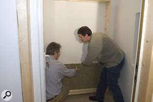 Once the wooden frame had been fixed in place, using a combination of screws and cavity-wall fixings, Paul and Hugh stacked a layer of Rockwool slabs to make up the back of the trap.