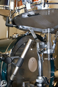 We used a harmonic exciter on Darren's recordings to compensate for a rather boxy snare sound. This suggested that we needed to capture more of the snare's 'snap'. After experimentation, we added Darren's AKG C451EB pencil condenser underneath the snare, which brought this out nicely.