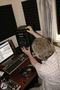 Studio monitors often include a switch to modify the high-pass filter, with higher frequency settings usually being more suitable for small rooms.