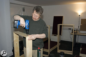Hugh glues and screws the corners of the frames.