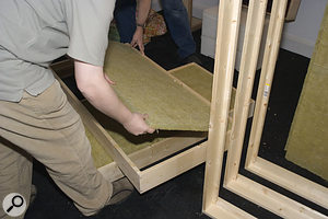 Fitting the rockwool slabs into the frames.