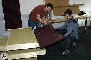 The foam panels go on top of the rockwool, secured with spray adhesive.