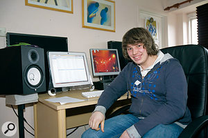 Paul Evans, in his newly overhauled home studio, complete with acoustic treatment behind and to the sides of his monitor speakers.