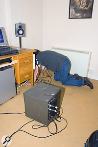 Placement of your subwoofer is important. Finding the right place is a matter of getting down on your hands and knees, moving around and listening to some well-recorded bass, with the sub in your normal listening position. When you've found where it sounds best, relocate the sub there.