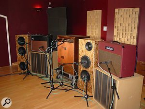 A selection of amps miked up ready for recording, including a Leslie (centre).