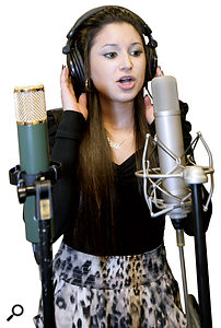 Josephine Permaul, singing classical vocals into the Microtech Gefell M92.1S, flanked by the AKG C12VR on the left.