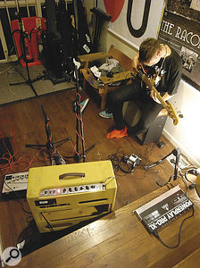 Sessions for xx were mostly recorded at night when the XL offices were empty. Here, Oliver Sim lays down a bass part through a Fender Bassman.