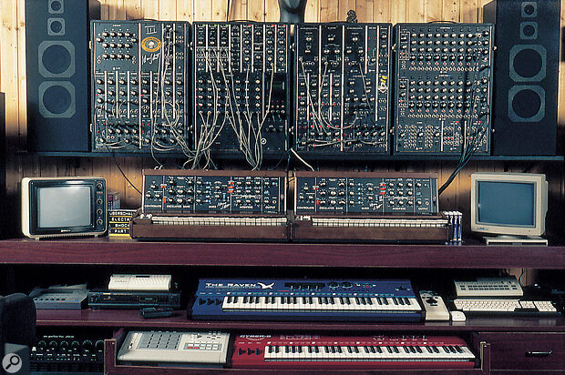 This shot of Klaus Schulze's studio illustrates both his affection for old Moog analogue synths (his four-module Moog C3 modular rig and two Minimoog keyboards) and his willingness to embrace new digital gear such as the Quasimidi Raven (blue keyboard) and Cyber 6 (red keyboard).