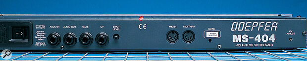 The MS404 rear panel features MIDI In and Thru DIN sockets, Gate and CV jacks, plus Audio In and Out.
