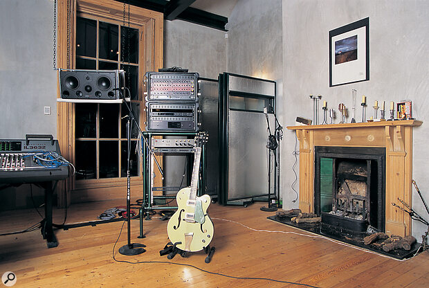 Alan's guitar and processing rack, containing his Drawmer compressors and gates, Lexicon PCM70 reverb, Yamaha SPX90 effects, and Roland R880 reverb/delay.
