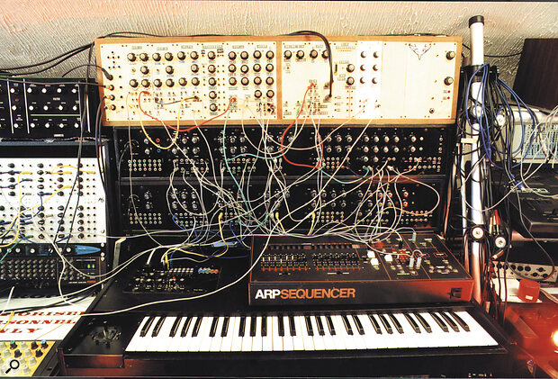 The kit format meant that Digisound modules appear in a variety of guises. The top row contains the system built by Dave Robinson (see 'Construction Time Again' box), using home‑made panels, while the two lower rows are custom black‑faced modules. Beneath the ARP sequencer is the polyphonic keyboard controller.