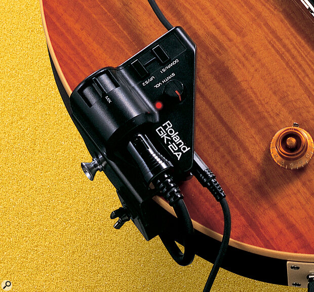The interface for the GK2A pickup needed to drive the GR33, with built‑in controls for accessing the two different modes. The unit can be firmly mounted, without damaging the guitar's finish, using the strap peg, as shown.