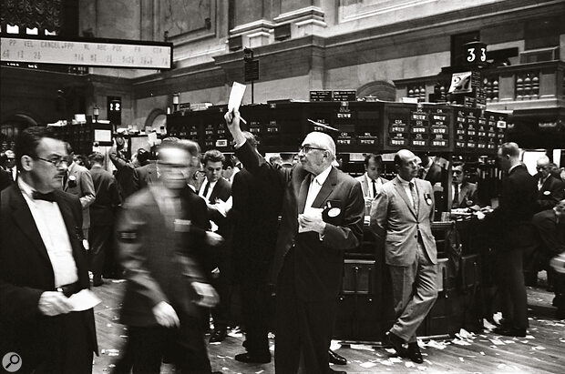 The New York Stock Exchange trading floor. A broker tries to sell his last remaining Yamaha CS80.