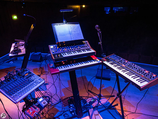 The on-stage nerve-centre of the project, effectively. Moog, Nord and Oberheim synths with Behringer mixer, Electro-Harmonix vocoder and Zoom multi-effects unit. Multiple expression pedals were used to control the synths while leaving hands free to play.