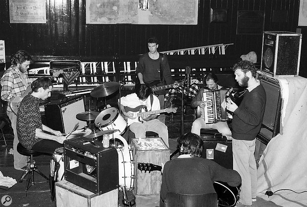 The musicians arranged around the single Calrec Soundfield mic. Margo Timmins was positioned outside of the main circle, but is represented by the Klipsch Heresy monitor on the right–hand side.