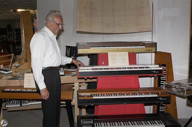 Ernst Zacharias poses with a selection of his creations at the Eboard Museum in Klagenfurt, Austria.