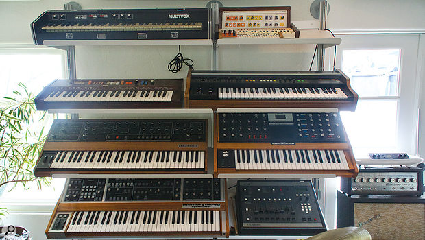 Emile Haynie's studio houses an impressive collection of keyboards, samplers and other electronic instruments, many of them dating from the days of classic '80s hip‑hop. Visible in this shot are, from top: Multivox MX‑20 and circuit‑bent Casio PT‑30; Casiotone 403 and Roland VP‑330 vocoder; Sequential Prophet‑5 and Moog Voyager; Moog Memorymoog and Haynie's beloved E‑mu SP‑1200 sampler.