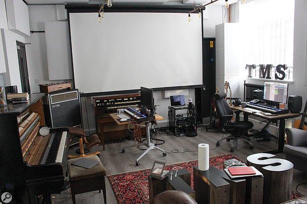 Another view of the main area in TMS's Grand Prix House studio. The projector was used to display the lyrics of whatever song they were currently working on.