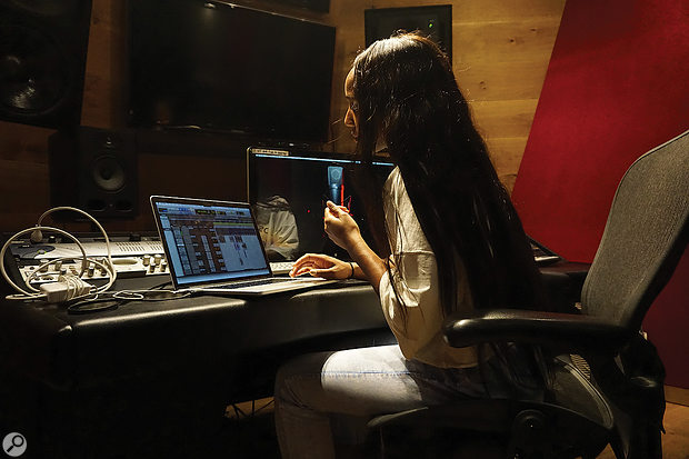 Lee's mixes for Luv Is Rage 2 were done entirely on her laptop, often with just the built-in audio I/O and a pair of Sennheiser headphones. This photo was taken at Means Street Studios in Atlanta.